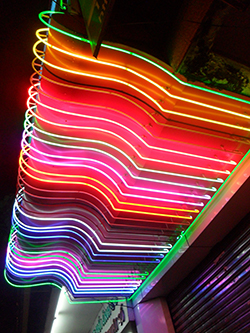 photo of colorful neon lights above a storefront