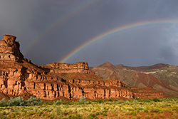 photo of rainbows over desert