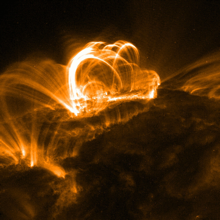 Solar Flares: Notice how they curve back to follow the magnetic field lines.