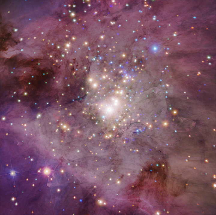 The Orion Nebula captured through NASAs Chandra X-ray Observatory and the Hubble Space Telescope.